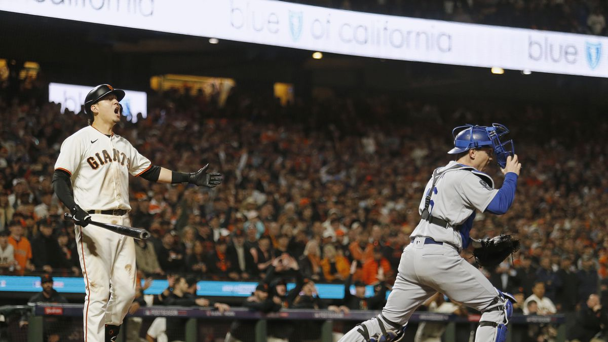 Wilmer Flores reacts after being called out on a controversial check swing call to end the NLDS while the Dodgers catching beings celebrating