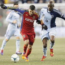 Real's Javier Morales tries to outrun Kansas City's Lawrence Olum with the ball as Real Salt Lake and Sporting KC play Saturday, Dec. 7, 2013 in MLS Cup action. Sporting KC won in a shootout.