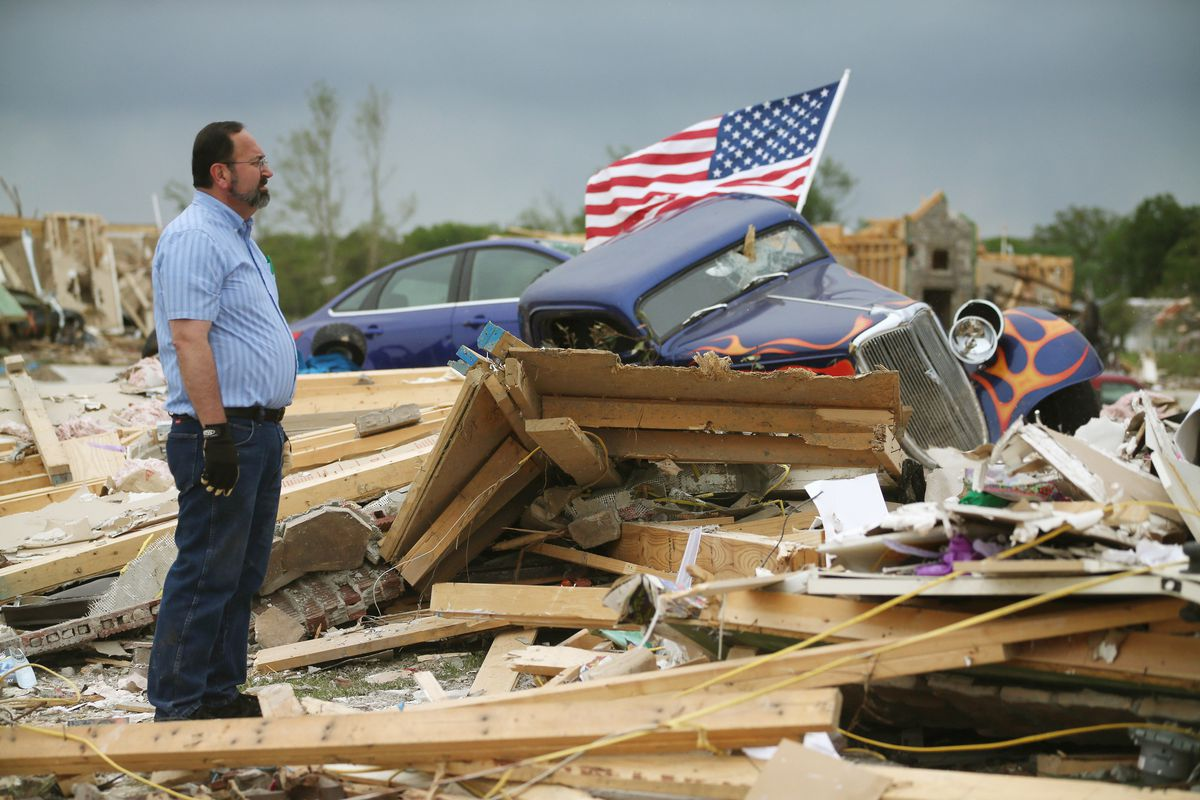 Dan Wassman looks at the debris at the homesite of his son, also named Dan Wassum, who was killed when a tornado destroyed his home April 29, 2014 in Vilonia, Arkansas.