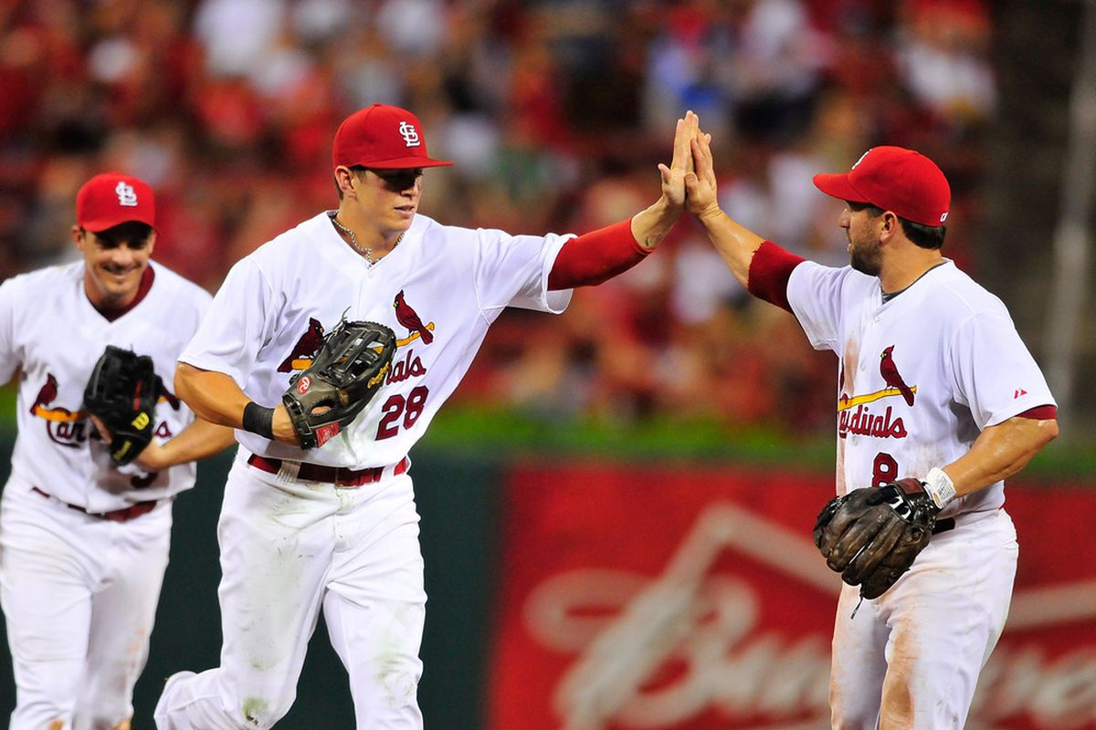 ST. LOUIS, MO - JULY 25: Colby Rasmus #28 of the St. Louis Cardinals high-fives Nick Punto #8 after making a diving catch against the Houston Astros at Busch Stadium on July 25, 2011 in St. Louis, Missouri.  (Photo by Jeff Curry/Getty Images)