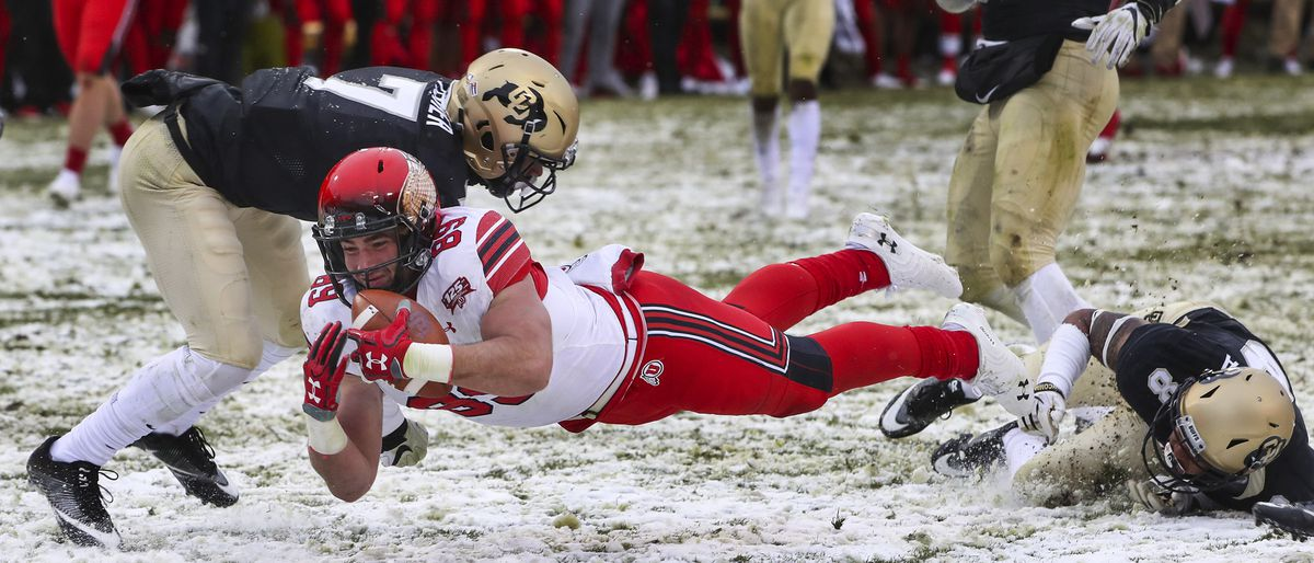 Utah Utes tight end Cole Fotheringham (89) dives for the golf line after hauling in a pass during the University of Utah football game against the University of Colorado at Folsom Field Boulder on Saturday, Nov. 17, 2018.