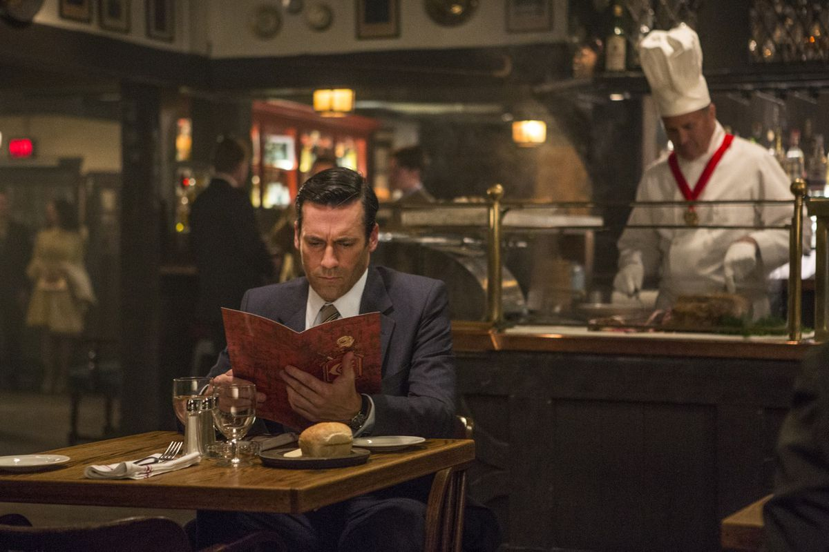 Don (Jon Hamm) takes time out of his busy schedule to grab a bite to eat.