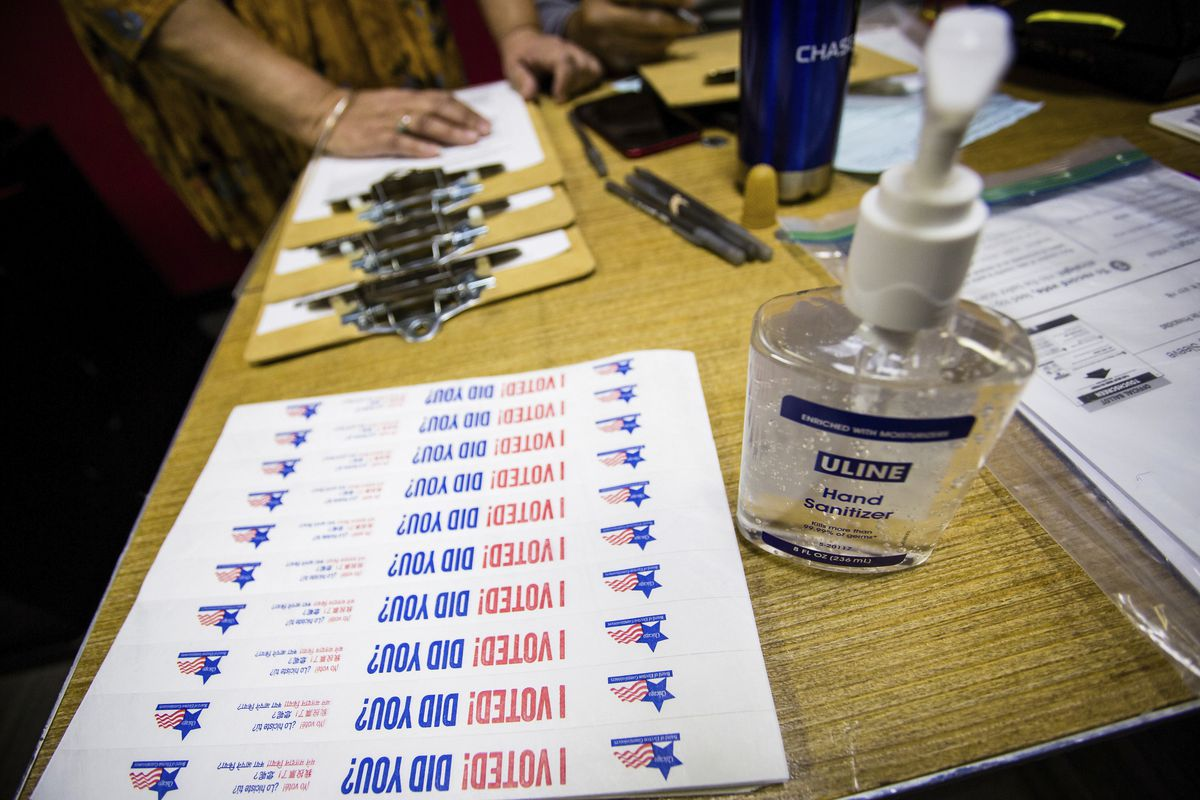 Hand sanitizer and stickers are set up at a First Ward polling place on Tuesday.