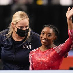 Simone Biles waves after competing in the floor exercise during the women's U.S. Olympic Gymnastics Trials Sunday, June 27, 2021, in St. Louis.