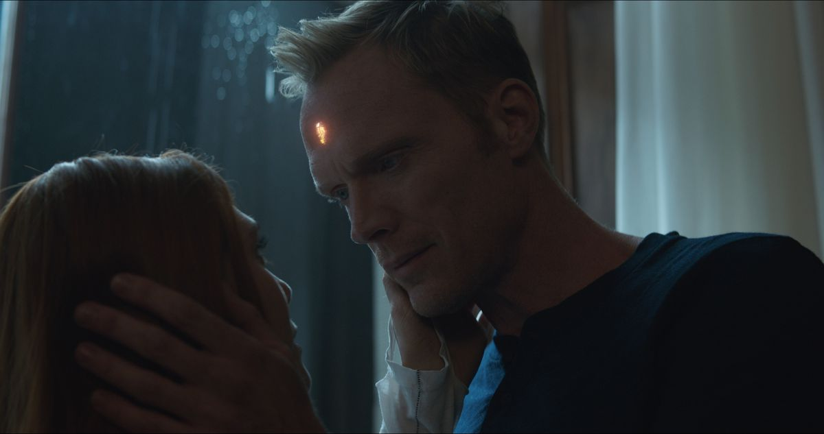Avengers: Infinity War - Scarlet Witch and Vision hold each other's faces