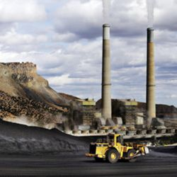 A loader moves coal at the Huntington power plant in Huntington, Tuesday, March 24, 2015.