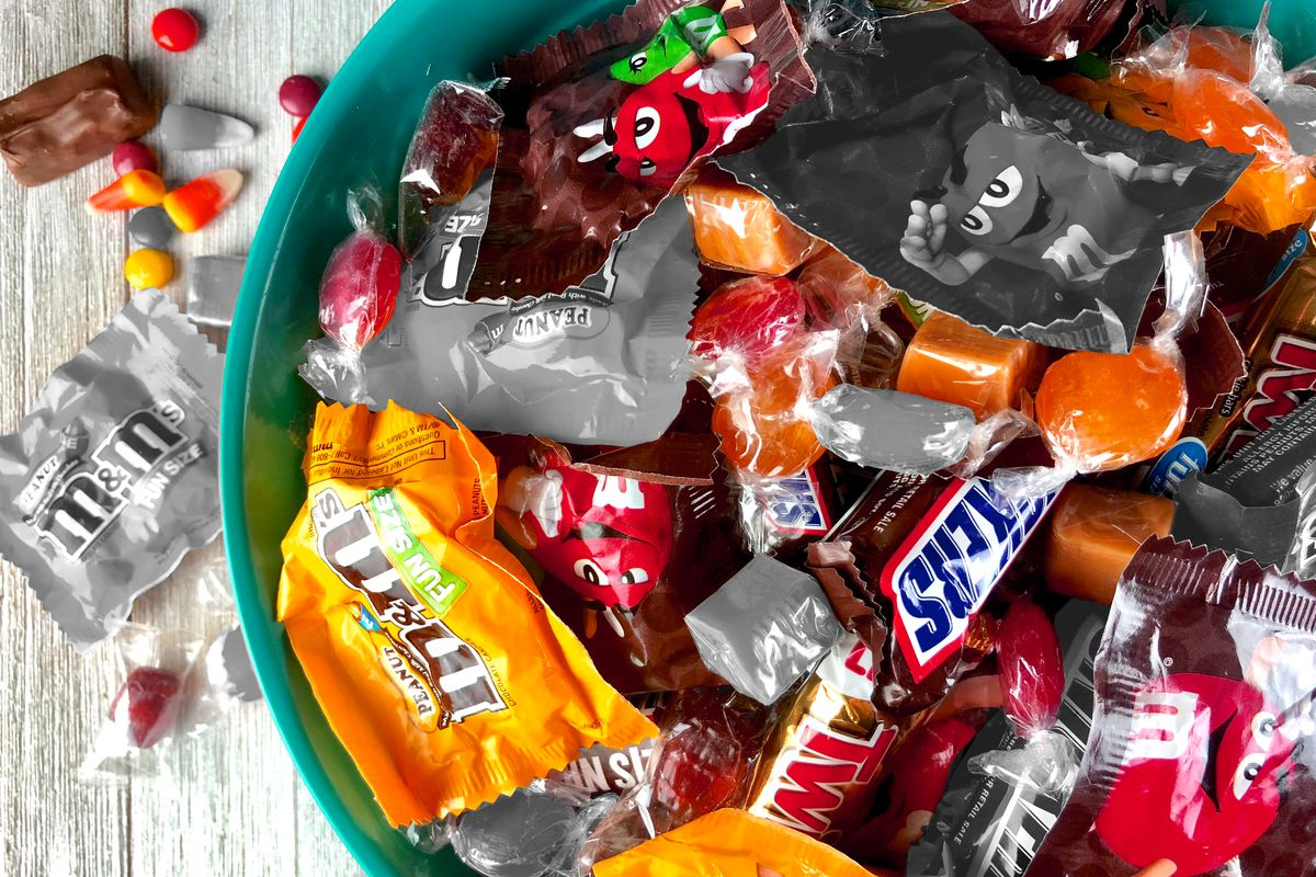An assortment of fun-sized Halloween candies in a bowl