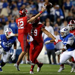 Utah Utes quarterback Charlie Brewer (12) jumps to get the pass off as BYU and Utah play an NCAA football game at LaVell Edwards Stadium in Provo on Saturday, Sept. 11, 2021. BYU won 26-17, ending a nine-game losing streak to the Utes.