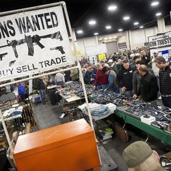 Crowds gathered around used weapons dealers at the South Towne Expo Center during the 2013 Rocky Mountain Gun Show, Saturday, Jan. 5, 2013.