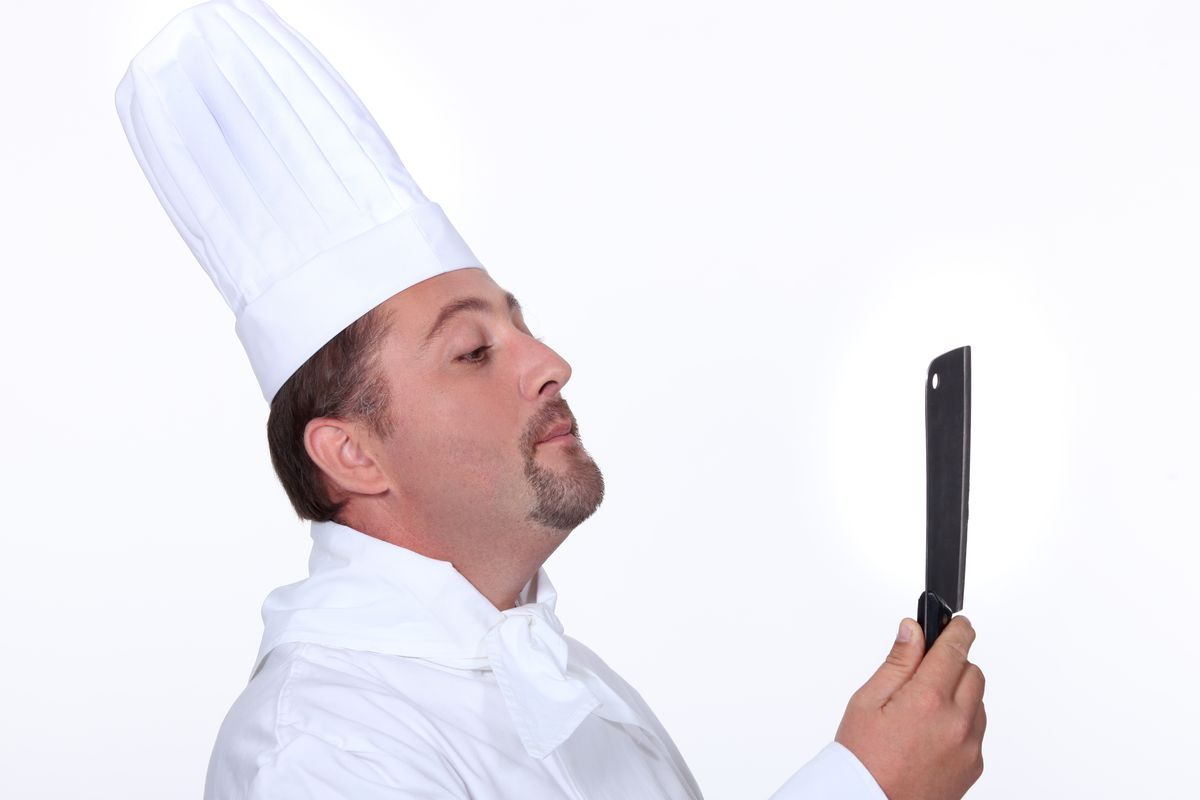 """a man polishing his knife"""