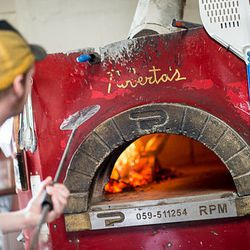 """<a href=""""http://ny.eater.com/archives/2014/06/robertas_is_currently_delivering_pizza_to_midtown.php"""">Roberta's Is Currently Delivering Pizza to Midtown</a>"""