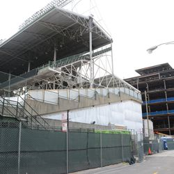12:27 p.m. Work in progress at Gate K, with the plaza building in the background -