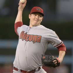 Arizona Diamondbacks starting pitcher Trevor Cahill throws to the plate during the first inning of their baseball game against the Los Angeles Dodgers, Friday, Aug. 31, 2012, in Los Angeles.