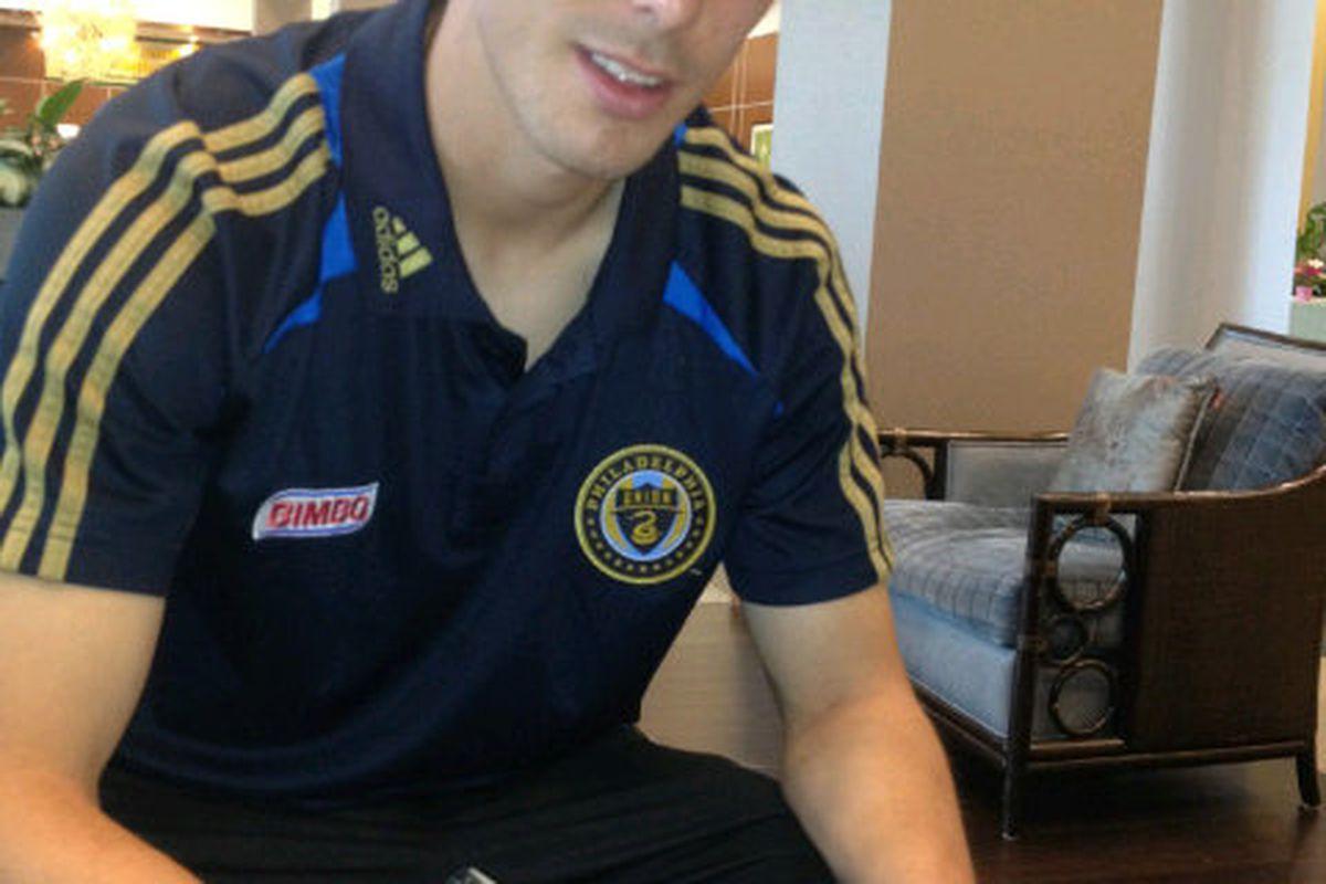 Krystian Witkowski signs his Philadelphia Union contract. (Photo courtesy of agent Ted Philipakos)