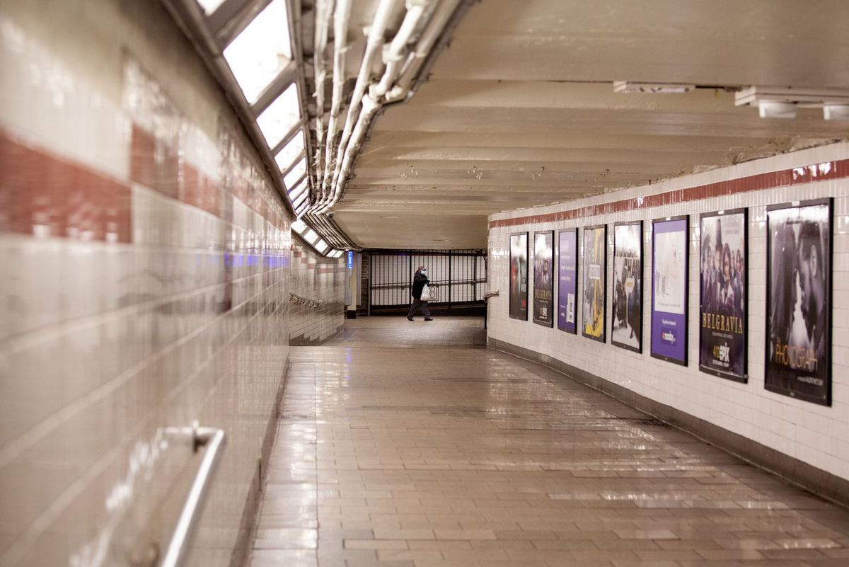 A person walks through an empty City Hall station during the coronavirus outbreak.