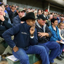 KC Carden, front, listens during a town hall meeting at the Salt Lake County Equestrian Park in South Jordan, Monday, April 25, 2016.