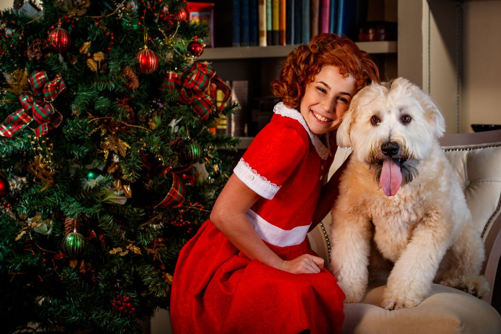 """Emily Zimmerman plays the role of Annie alongside Sweets the dog as Sandy in Theatre at the Center's new production of """"Annie Warbucks"""" in Munster, Indiana.   Photo by Guy Rhodes"""