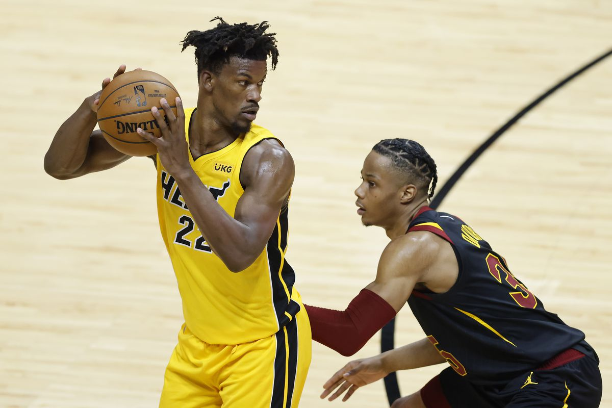Jimmy Butler #22 of the Miami Heat is defended by Isaac Okoro #35 of the Cleveland Cavaliers during the third quarter at American Airlines Arena on March 16, 2021 in Miami, Florida.