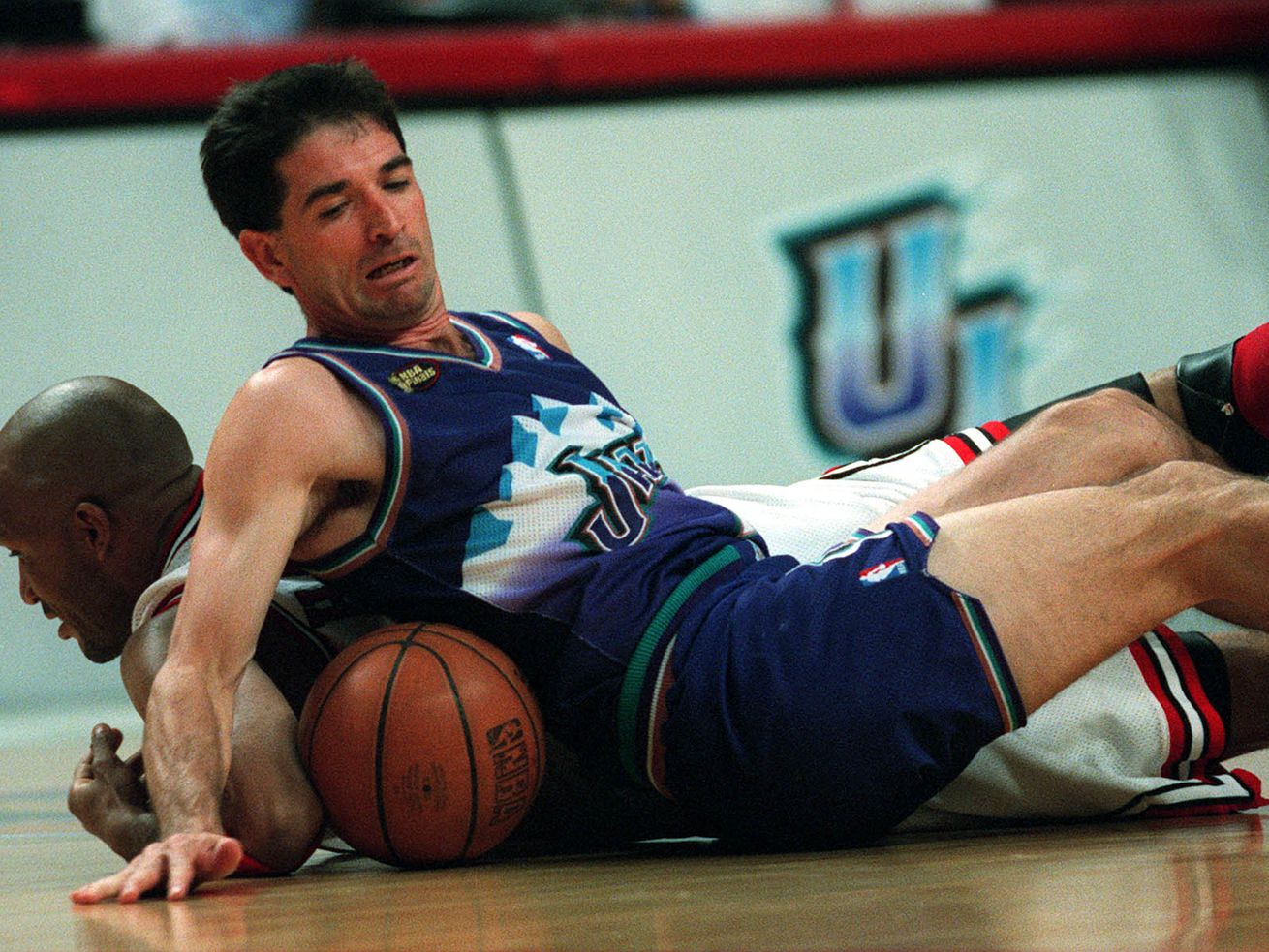 John Stockton and Ron Harper tangle over loose ball. Allred/photo