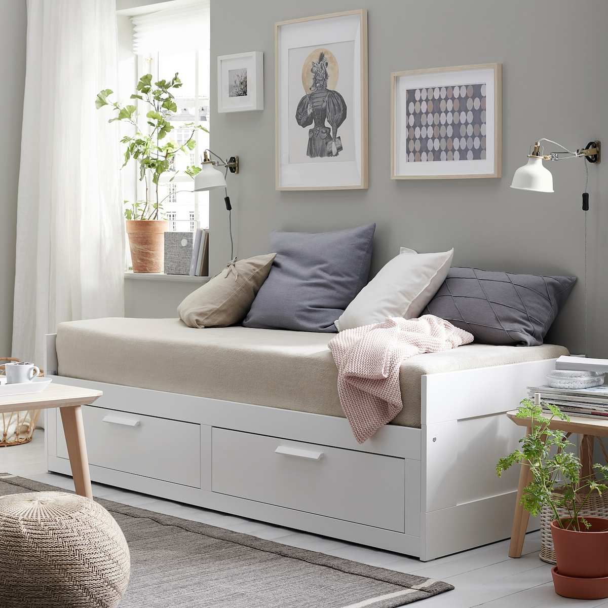 White daybed with beige padding.