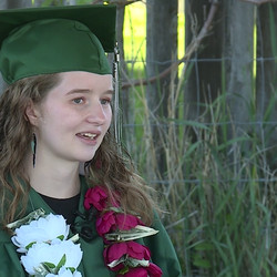 Deserae Turner is pictured in her cap and gown during a drive-by graduation celebration in her front yard in Amalga, Cache County, on Wednesday, May 27, 2020. Turner, who was shot in the head by two classmates in February 2017, graduated from Green Canyon High School Wednesday. Because of thecoronavirus pandemic, Turner was not able to receive her diploma in person.