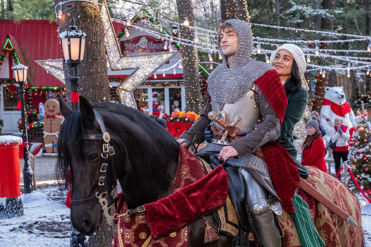 Brooke (Hudgens) hangs onto Cole (Whitehouse) atop a horse.