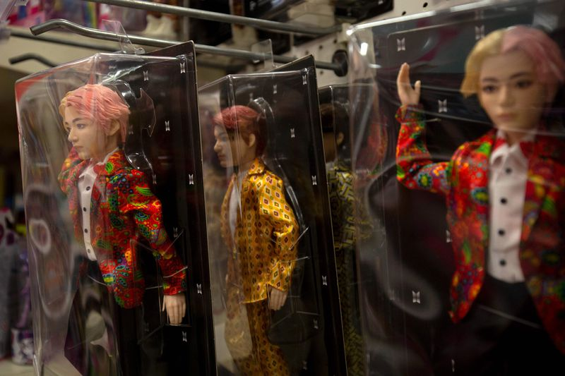 South Korean boy band BTS toy dolls are seen at a store in Washington, DC.