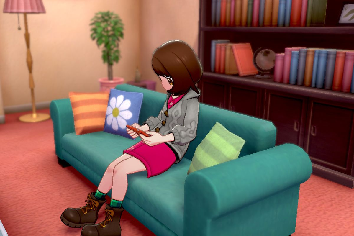 A Pokémon trainer sitting on the couch with her Rotom phone
