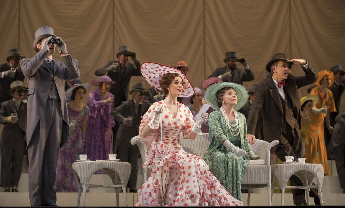 """Eliza Doolittle (Lisa O'Hare, in polka-dot dress), with Mrs. Higgins (Helen Carey, in green) and her son, Professor Henry Higgins (Richard E. Grant), in the Lyric Opera of Chicago production of """"My Fair Lady."""" (Photo: Todd Rosenberg Photography)"""