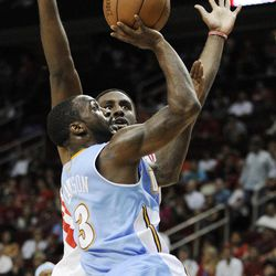 Denver Nuggets' Ty Lawson (3) shoots in front of Houston Rockets' Patrick Patterson in the first half of an NBA basketball game Monday, April 16, 2012, in Houston.