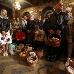 Ukrainian Orthodox believers attend an Orthodox Easter service in the Kyiv-Pechersk Lavra church (Cave Monastery) in the capital city of  Kiev, Ukraine, on May 1, 2016.