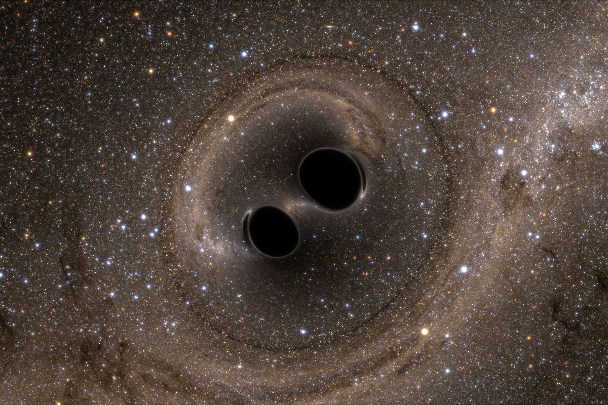 The collision of two black holes—an event detected for the first time ever by the Laser Interferometer Gravitational-Wave Observatory, or LIGO—is seen in this still from a computer simulation.