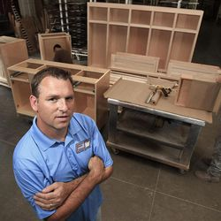 """In this Wednesday, Sept. 5, 2012 photo, Aaron Foust, who owns a wood refinishing company, poses for a photo in his workshop in Streetsboro, Ohio. Foust, a former Gov. Mitt Romney supporter, says President Barack Obama's words about welfare recipients don't match his deeds. Publicly, Foust says, the president is urging """"them to go to work, but if they (did) ... they wouldn't need him anymore. He needs their vote. As long as they're dependent on the government, they're going to vote for the people that give them money."""" (AP Photo/Tony Dejak)"""