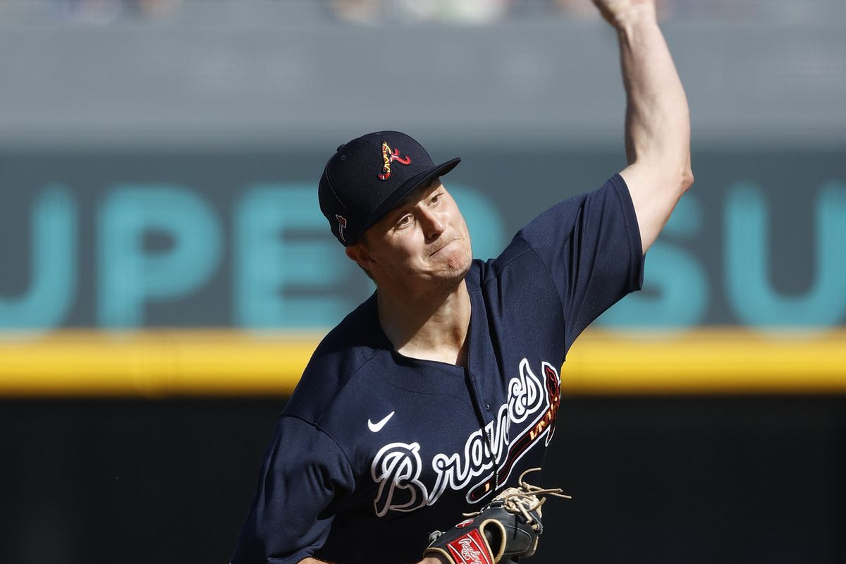 Tucker Davidson delivers a pitch in spring training