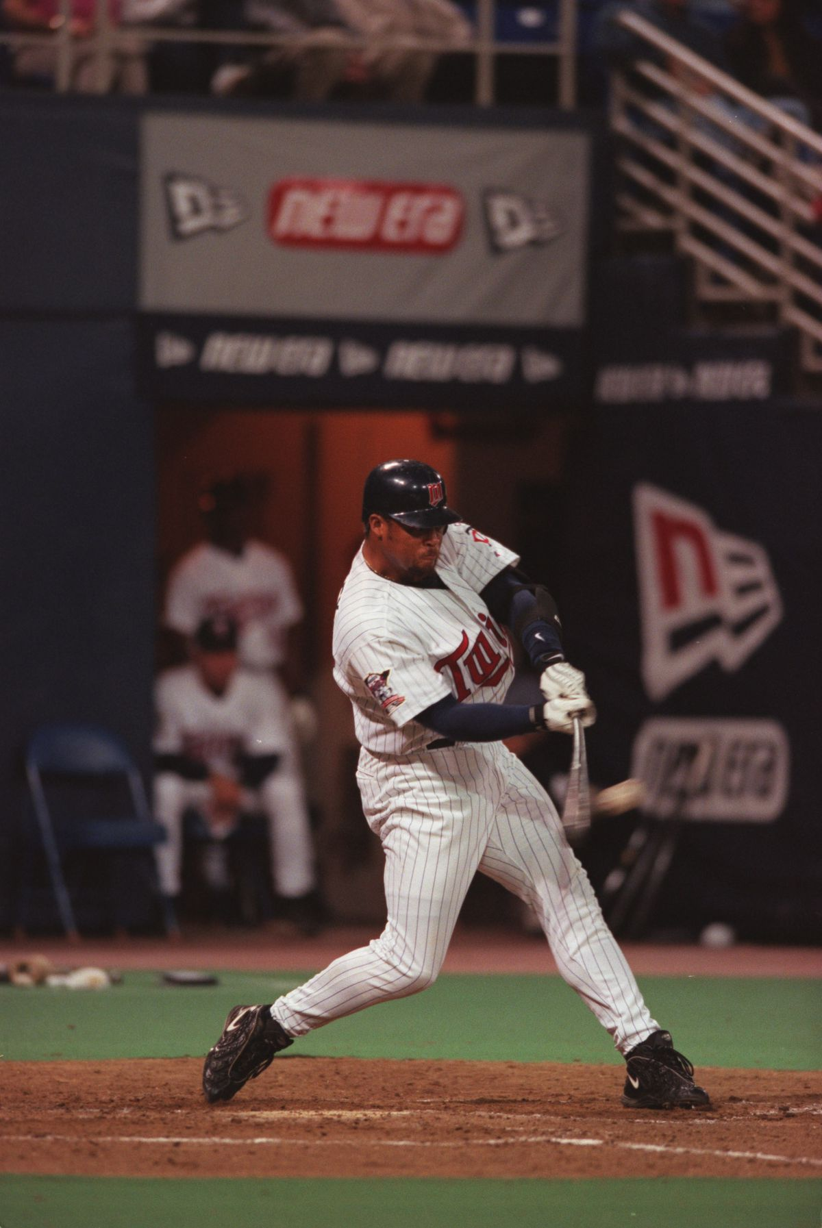 Twins vs. Devil Rays - 04/04/2000. Butch Huskey hits in Corey Koskie early in Tuesday night's game against the Tampa Bay Devil Rays.