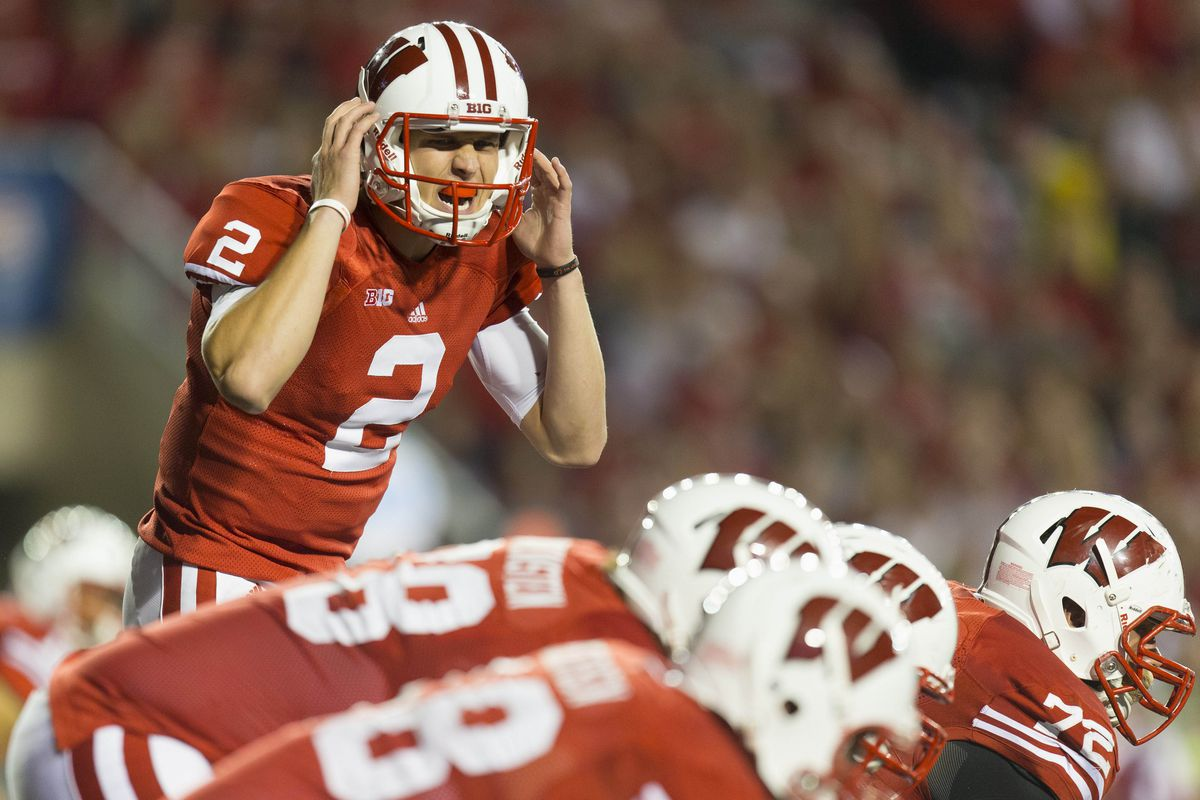 Sep 15, 2012; Madison, WI, USA; Wisconsin Badgers quarterback Joel Stave (2) signals during the fourth quarter against the Utah State Aggies at Camp Randall Stadium. Wisconsin defeated Utah State, 16-14. Mandatory Credit: Jeff Hanisch-US PRESSWIRE