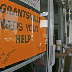 A sign at Denny's asks for help to replace school supplies lost in the fire. Volunteers collected donations Saturday.