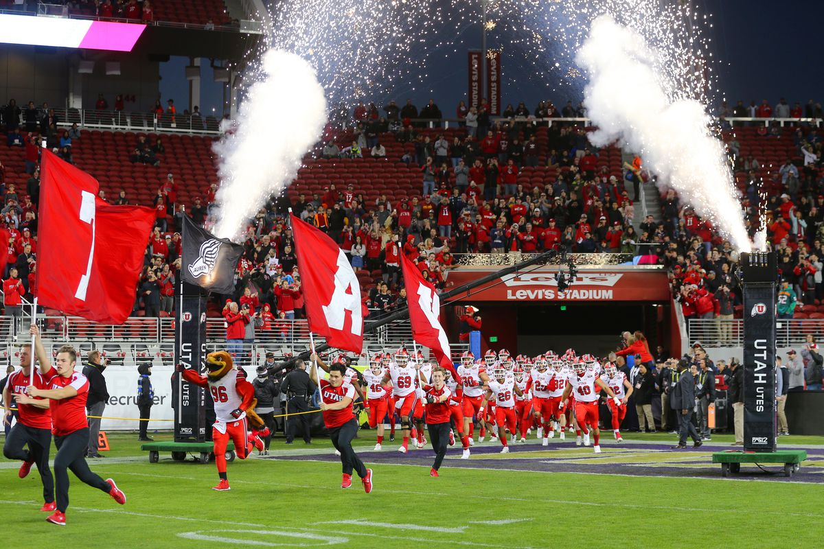 Utah runs onto the field as they and Washington play in the Pac-12 Championship game at Levi's Stadium in Santa Clara on Friday, Nov. 30, 2018.