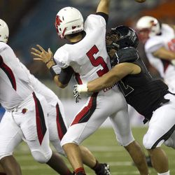 Lamar quarterback Ryan Mossakowski fumbles the ball after being hit by Hawaii defensive lineman Beau Yap during the third quarter of the NCAA game between the Lamar and Hawaii, Sept. 15, 2012 in Honolulu.