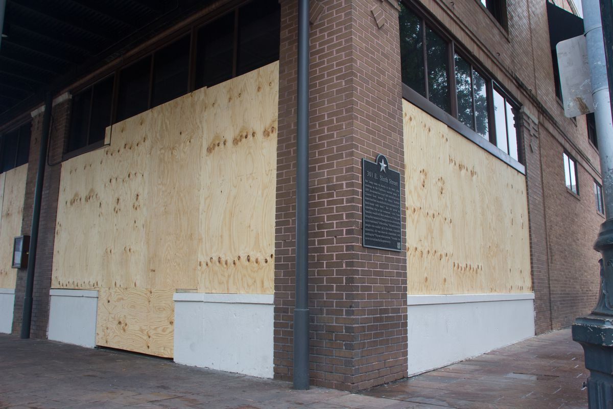 The boarded-up windows of Austin restaurant Parkside