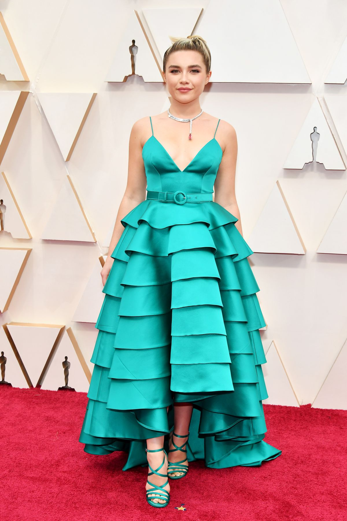 Florence Pugh attends the 92nd Annual Academy Awards in a teal Louis Vuitton dress.