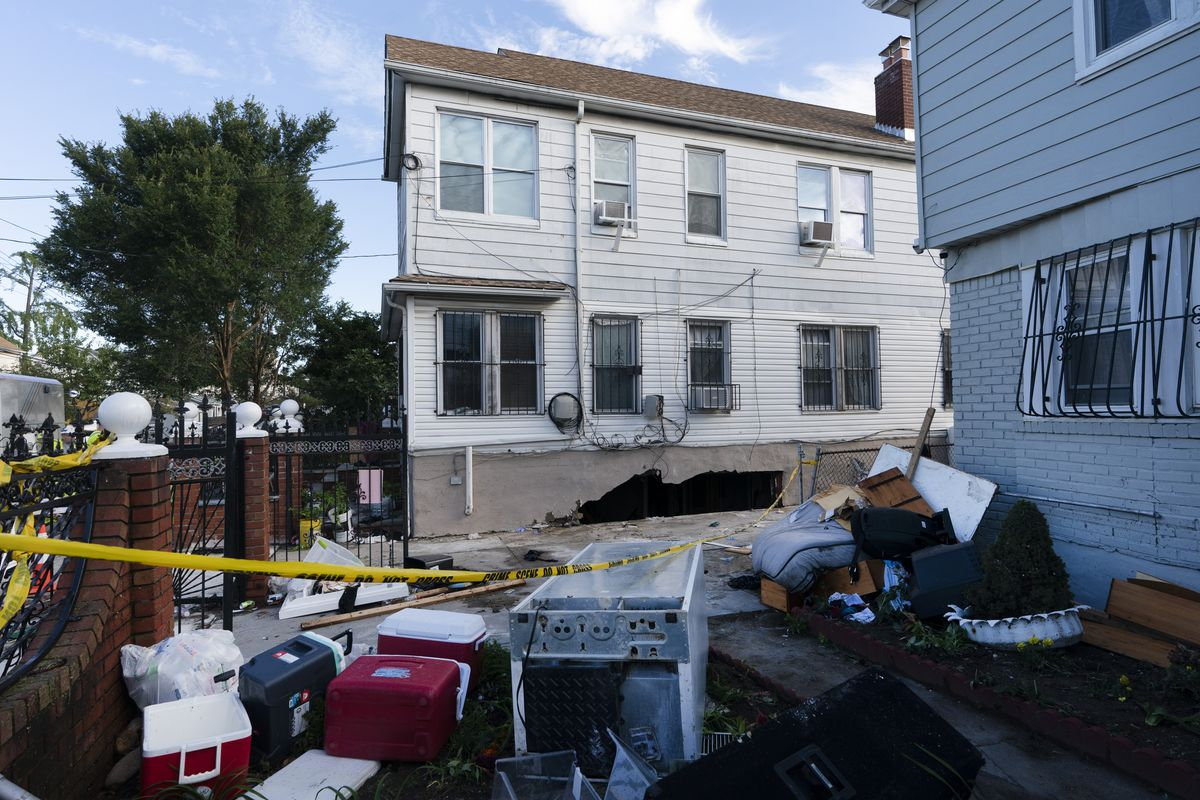 Damage to the side of a building from the remnants of Hurricane Ida is shown on Thursday, Sept. 2, 2021 in the Queens borough of New York. Three people were killed when several feet of water collapsed the wall to their basement apartment and flooded the apartment.
