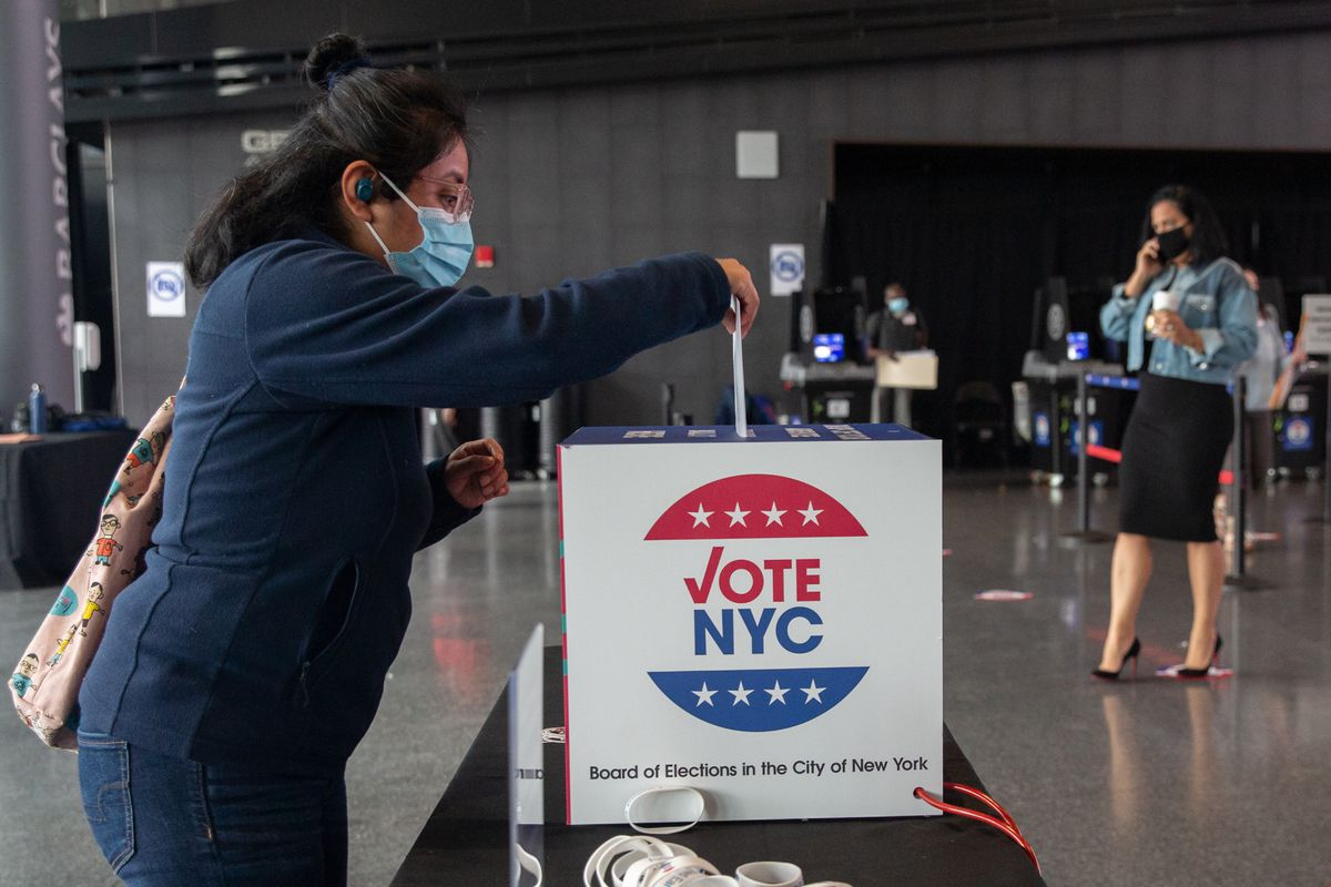 A Brooklynite drops off an ballot at the Barclays Center on the first day of early voting, Oct. 24, 2020.