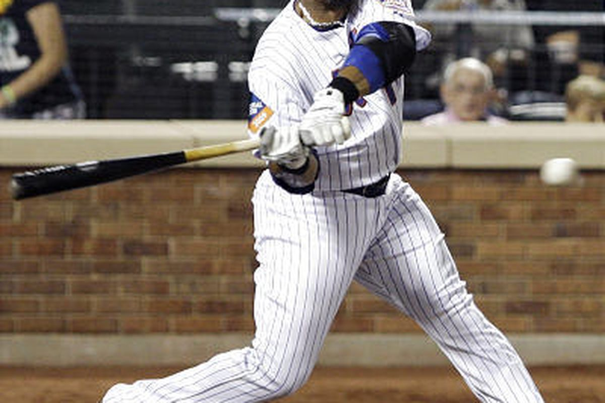 New York Mets' Gary Sheffield swings on a two-run double during the fourth inning Tuesday.