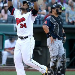 The Salt Lake Bees' Cesar Puello crosses home plate after hitting a home run during a baseball game against the Reno Aces in a baseball game at Smith's Ballpark in Salt Lake City on Monday, June 26, 2017. The Bees wore Trappers jerseys for '80s throwback night.