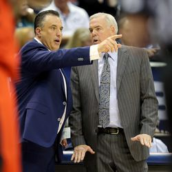 BYU assistant basketball coach Heath Schroyer head coach Dave Rose talk as BYU and Illinois State play in Provo on Wednesday, Dec. 6, 2017. BYU won 80-68.