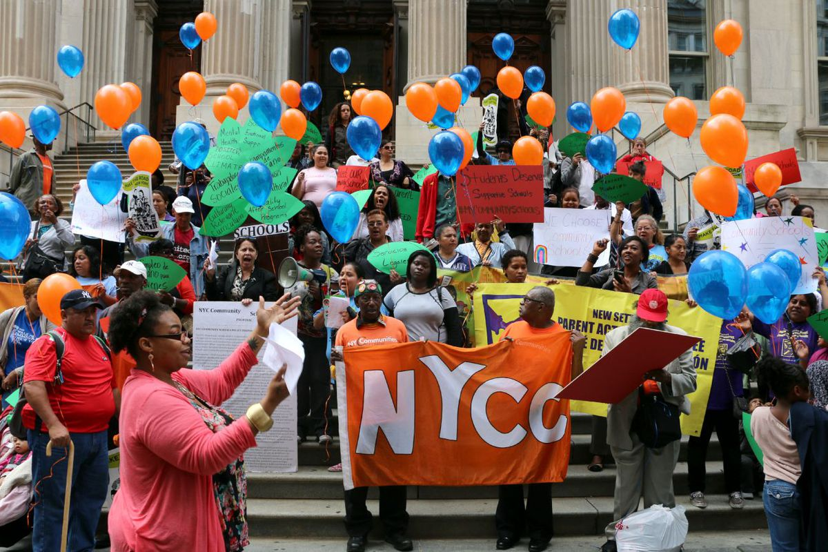 Community school proponents rallied in front of education department headquarters Tuesday.