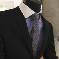 """When it comes to investing in that one essential suit, Trinidad recommends it be solid <strong>navy</strong>. """"When it comes to navy, it's one of those colors where you can mix it with any other colors and it blends well,"""" he says. It also transitions eas"""