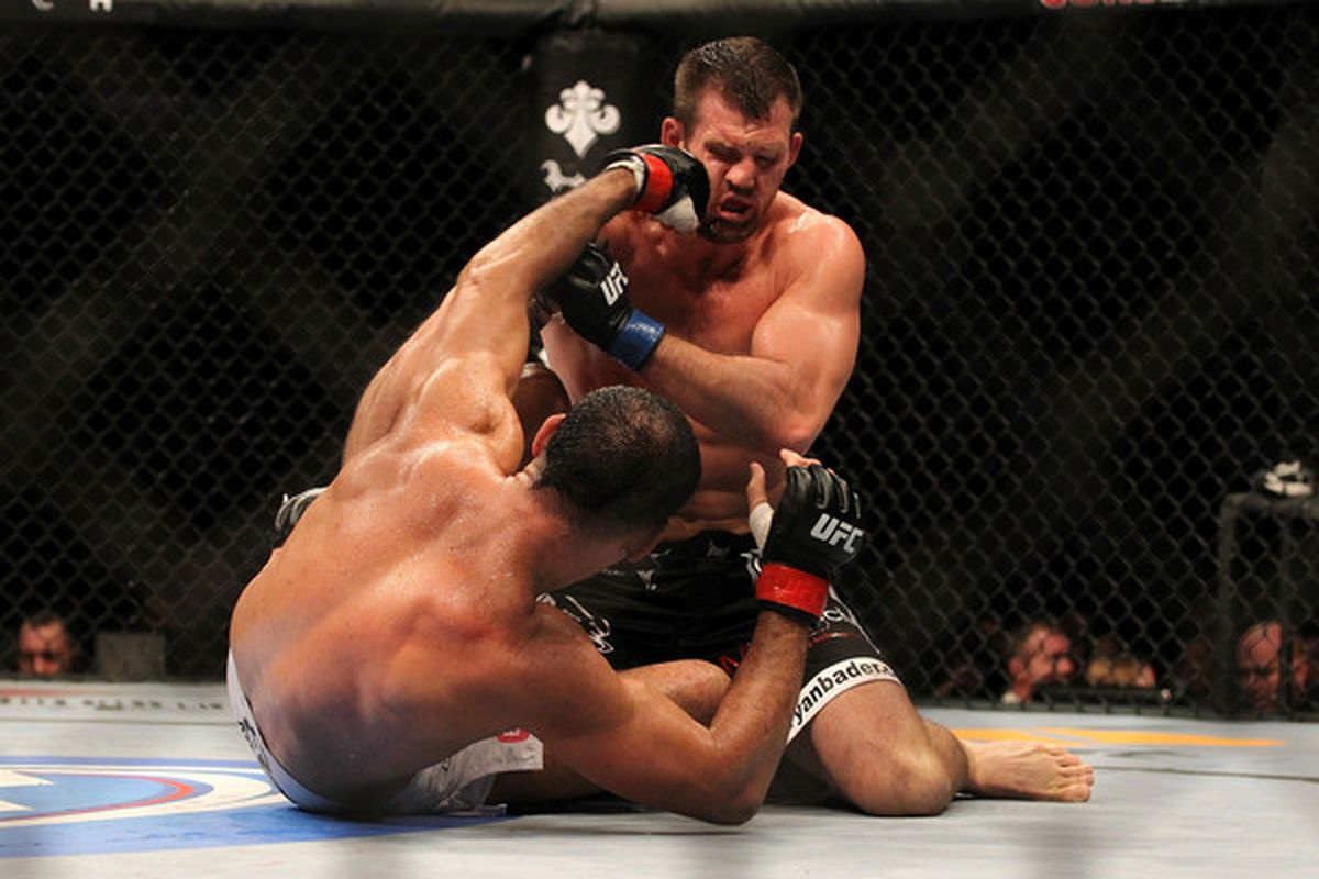INDIANAPOLIS - SEPTEMBER 25:  Ryan Bader (top) is punched by Rogerio Nogueira during their UFC light heavyweight bout at Conseco Fieldhouse on September 25 2010 in Indianapolis Indiana.  (Photo by Al Bello/Zuffa LLC via Getty Images)