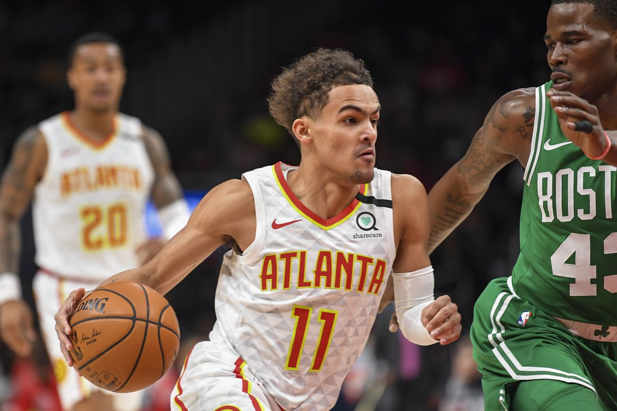 Atlanta Hawks guard Trae Young dribbles against Boston Celtics guard Javonte Green during the first quarter at State Farm Arena.
